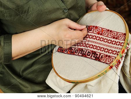 Embroidery On Embroidery Frame (cross-stitch)