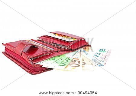 Red wallet full with euro banknotes on a white background.