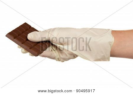 Milk chocolate in confectioner hand