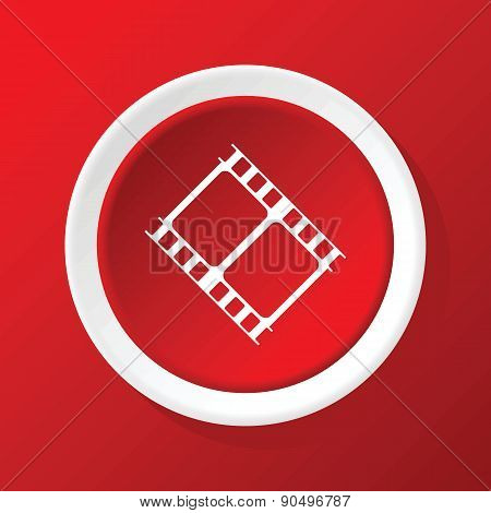 Film strip icon on red