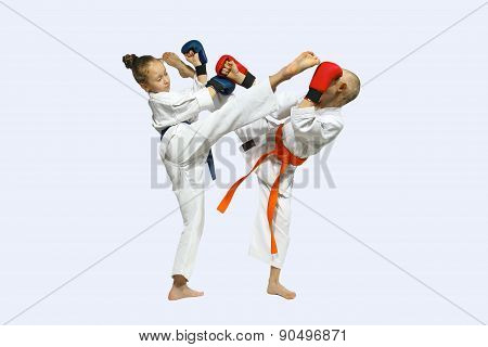The blows mawashi geri are training athletes with overlays on hands