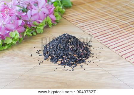Blend Of Black Tea On A Table With Colours.