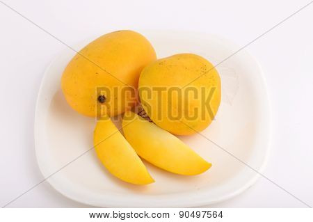 Mango fruit in plate on white