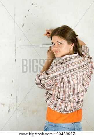Woman Measuring  Wall