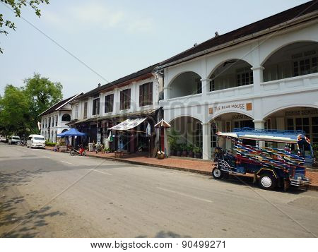 deserted street with local transport in Laos