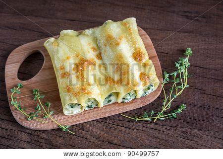 Cannelloni With Ricotta And Spinach On The Wooden Board