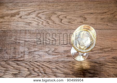 Glass With White Wine On The Wooden Background