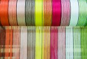 picture of silk worm  - Multicolored silk fabric weaving is seen in rural Thailand - JPG