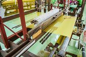 stock photo of silk worm  - Machines for weaving silk common in rural Thailand - JPG