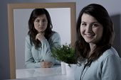 stock photo of lonely woman  - Lonely young woman with bipolar personality disorder - JPG