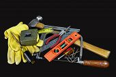 pic of pliers  - Carpenter tools hammer nails screws level tape measure screwdrivers pliers and hacksaw isolated on black background - JPG