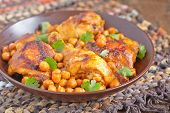 picture of curry chicken  - Curry Chicken With Chickpeas on a table - JPG