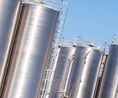 stock photo of silos  - Detail of chemical plant silos and pipes - JPG