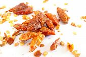 foto of chillies  - dry chilli and seeds on white background macro photo - JPG