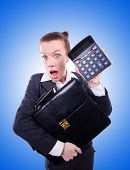 image of nerd  - Nerd female accountant with calculator - JPG