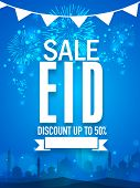 stock photo of eid festival celebration  - Shiny fireworks and mosque silhouette decorated sale poster - JPG