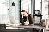 Tired And Sleepy Young Business Woman At The Desk With A Laptop poster