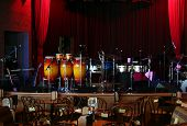 stock photo of drum-set  - stage is set in a jazz club - JPG
