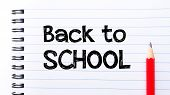 picture of red back  - Back to School Text written on notebook page red pencil on the right - JPG