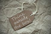 image of thinking outside box  - One Beige Label Or Tag With White Ribbon On Crumpled Paper Background - JPG