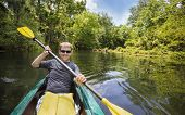stock photo of canoe boat man  - Smiling - JPG