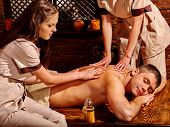 stock photo of ayurveda  - Man  having oil Ayurveda wooden spa treatment - JPG