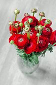 stock photo of buttercup  - Colorful romantic bouquet of flowers ranunculus buttercup macro spring on vase card - JPG