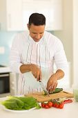 picture of diners  - middle aged man preparing diner in home kitchen - JPG
