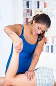 image of physiotherapy  - young woman lying while getting a leg massage from specialist concept of physiotherapy - JPG