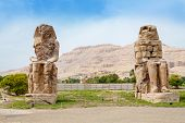 picture of pharaoh  - The Colossi of Memnon are two giant stone statues of Pharaoh Amenhotep III - JPG