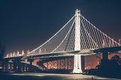 stock photo of bridges  - Oakland Bay Bridge During Night Hours - JPG