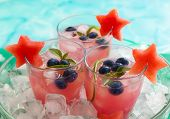 foto of watermelon  - Watermelon and blueberry drink in glasses with slices of watermelon in star shape - JPG