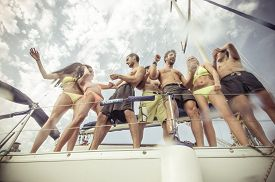 foto of boat  - group of friends making party on the boat - JPG
