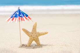 picture of starfish  - Patriotic USA background with starfishes and decorations on the sandy beach - JPG