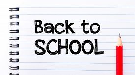 stock photo of red back  - Back to School Text written on notebook page red pencil on the right - JPG