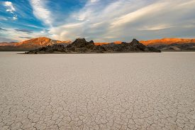 pic of flat-bed  - Dry lake bed on sunset - JPG