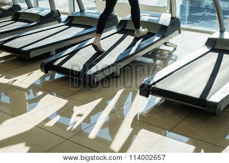 Treadmills in gym hall.
