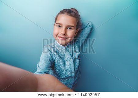 teen girl of European appearance seven  years doing self Lenses