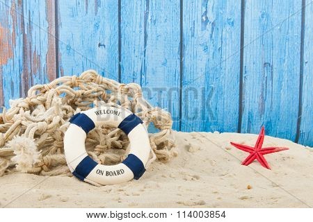 Life buoy with welcome at the beach