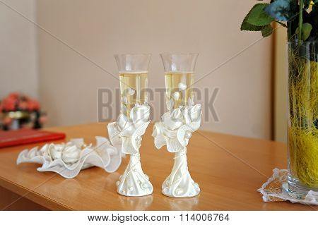 Two Wedding Glasses Decorated With Champagne