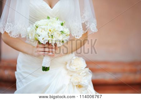 Wedding Bridal Bouquet In The Hands Of Ivory Color