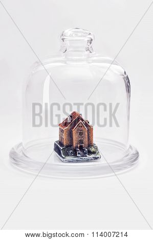 Small House Under The Protection Of A Glass Cover