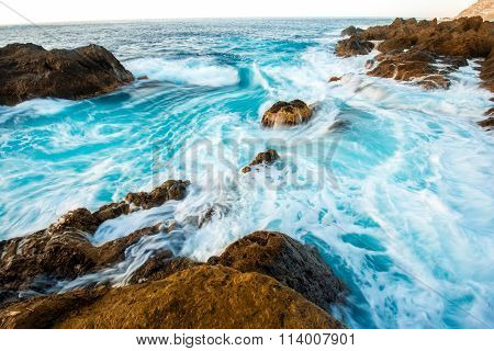 Seascape view on rocky coast with waves