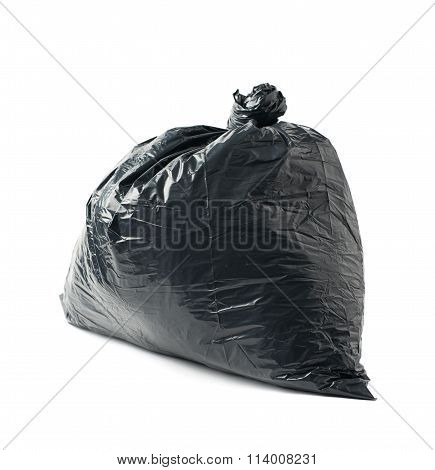 Closed black garbage bag isolated