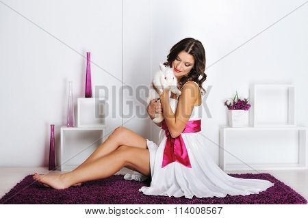 Beautiful Woman Playing With Rabbit