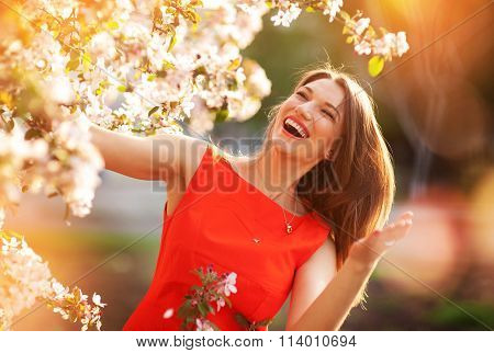 Happy Woman In Spring Flowering Trees