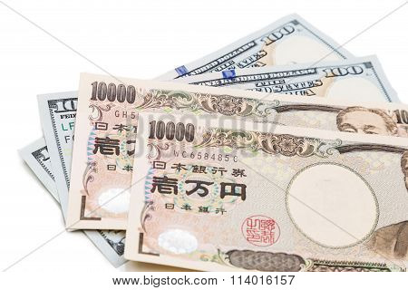 Close Up Of Japanese Yen Currency Note Against Us Dollar.