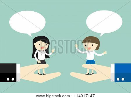 Business concept, Business women standing on the big hand and talking to each other.