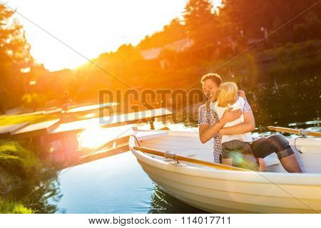 Hugging father and son in boat