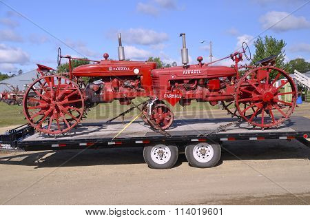 Restored Farmall tractors transported